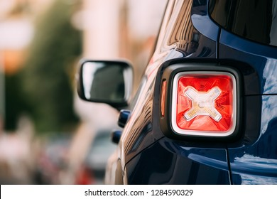 Terracina, Italy - October 15, 2018: Red Led Rear Lights Of Blue Jeep Renegade Bu/520 Car Parking At Street. Back View