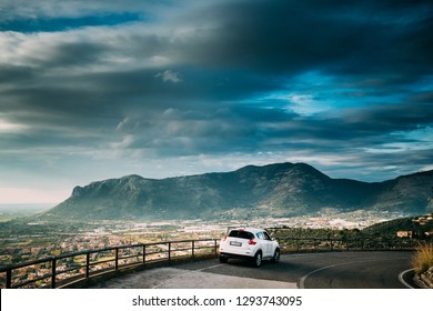 Terracina, Italy - October 15, 2018: White Color Car Nissan Juke Pre-facelift Parked On Road On Background Beautiful Landscape With Mountains In Italy