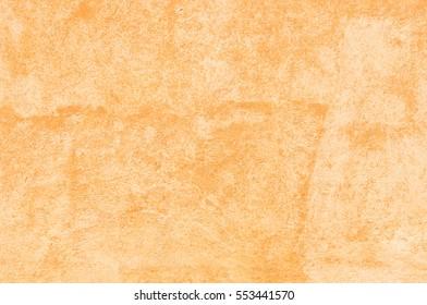 Terracotta background.