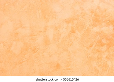 Terracotta brown colored plaster wall.