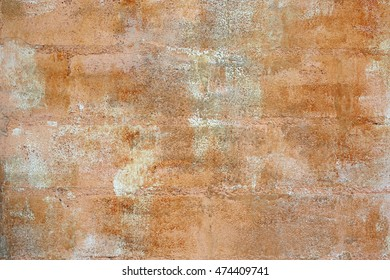 terracotta colored texture on wall
