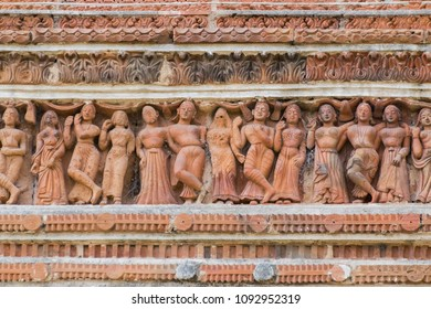 Terracotta decorations on the walls at Pratapeswar Temple at Kalna, West Bengal, India. Terracotta is a brownish-red clay that has been baked and is used for making things.