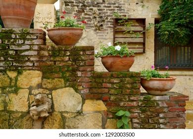 Terracotta flowerpots on an outdoor staircase wall in hillside town of Yesilyurt, Malatya, Turkey - November 12, 2012
