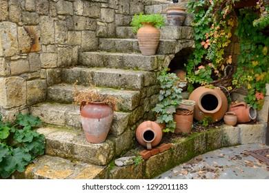 Terracotta flowerpots on an outdoor stone staircase in hillside town of Yesilyurt, Malatya, Turkey - November 12, 2012