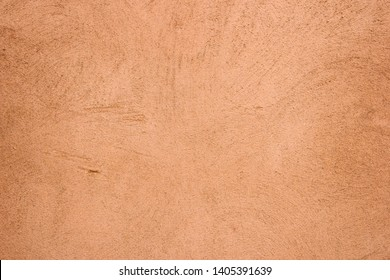 Terracotta plaster wall texture detailed close up