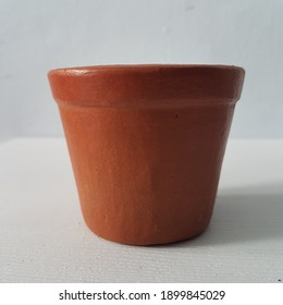 Terracotta pot on white background. Earthenware flower pot. Pot terakota.