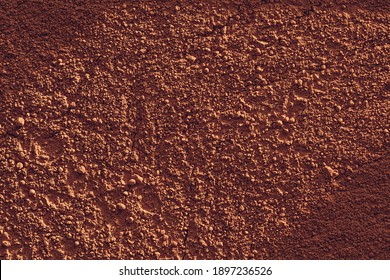 Terracotta powder soil or clay-like texture background.