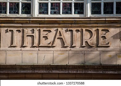 Terracotta tile sign saying 'Theatre' at the entrance to the historic venue in Richmond-Upon-Thames, West London.  The Victorian theatre was designed by Frank Matcham.