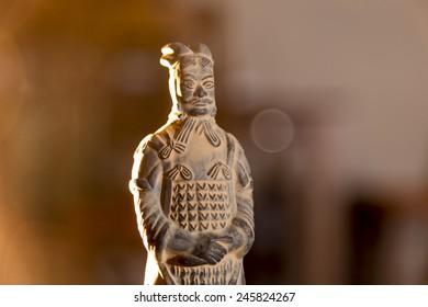 terracotta warrior in a dusty atmosphere