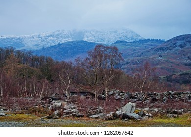 The terrain above Hodge Close Quarry, with distant mist capping the fells of the Langdales