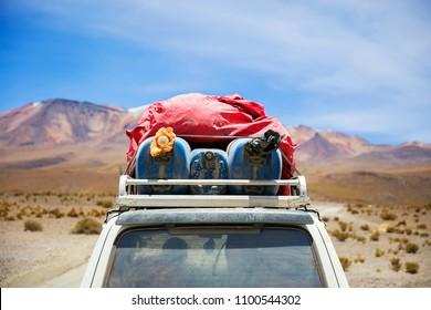Terrain vehicle in Dali desert at Eduardo Avaroa Andean Fauna National Reserve in Bolivia