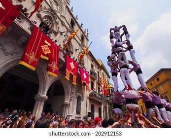 TERRASSA, SPAIN - JUNE 30, 2013: Castells Performance during the Festa Mayor 2013 in Terrassa, Catalonia, Spain. A castell is a human tower built traditionally in festivals within Catalonia.