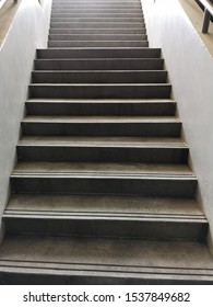 terrazzo stairs of the entrance to the basement are very wide.