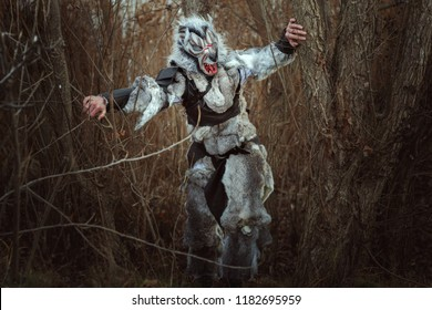 Terrible creature resembling a human wolf in the forest.