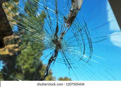 Terrible dangerous car after a fatal accident. Broken windshield. A broken car with broken glass. Сar hazard. Reckless dangerous driving. Broken windshield after fatal accident with a pedestrian