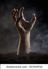 Terrible hand of dead on dark background