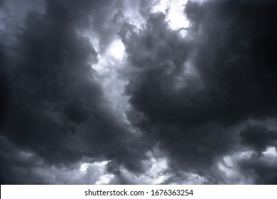 Terrible thunderclouds from the side of a plane. Gloomy epic clouds. Background image in a dark gray style.