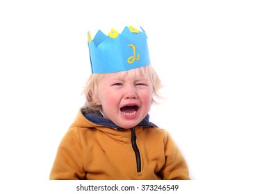 terrible twos, grumpy two year old boy with the crown