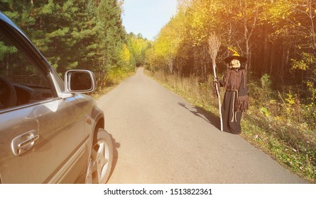 Terrible witch on rural road. Halloween concept.