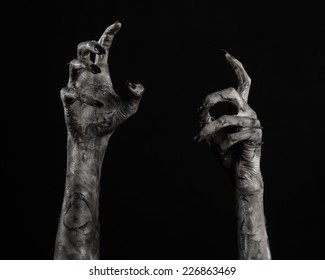 terrible zombie hands, dirty hands of the mummy, zombie theme, halloween theme, black background, isolated, black hand of death with black fingernails, monstrous art