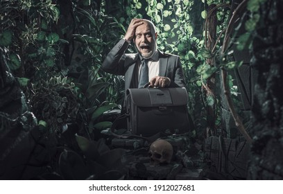 Terrified businessman lost in the jungle, risky business concept