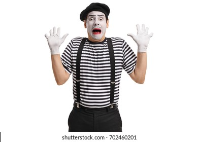 Terrified mime artist isolated on white background