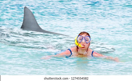 Terrified swimmer fleeing from white shark. Summer holidays risks. Travel and life insurance theme.