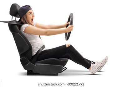 Terrified teenage girl driving and breaking to avoid an accident isolated on white background