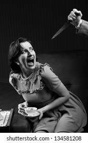 Terrified woman by a man murderess with a knife. Classic film noir style