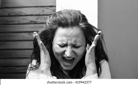 Terrified woman screaming - black and white photography. Breakdown concept