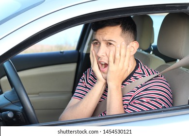 Terrified young male driver feeling guilty
