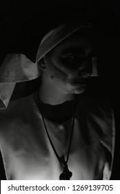 Terrifying face of nun on Halloween night. Nun of evil. Murder nun.