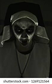 Terrifying nun on Halloween night. Nun of evil. Murder nun.