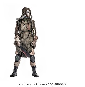 Terrifying post apocalyptic human creature, person survived in poisoned by pollution, post nuclear catastrophe world wearing tatters and full-face gas mask isolated on white background studio shoot