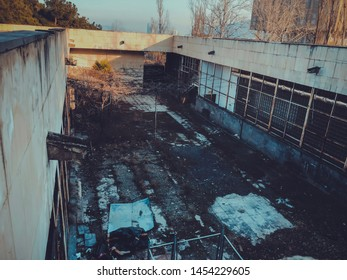 Territory of abandoned industrial area. Factory ruins.