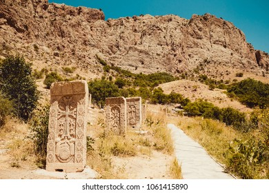 Territory Noravank monastery with khachkars. Armenian culture. Architecture concept. Pilgrimage place. Religion background. Travel to Armenia. Tourism industry. Tourist landmark. Mountain landscape