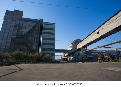 The territory of the old plant. Buildings for food storage and transportation. The metal structures of the tower and towers in the obsolete plant of Eastern Europe, the impact on environmental