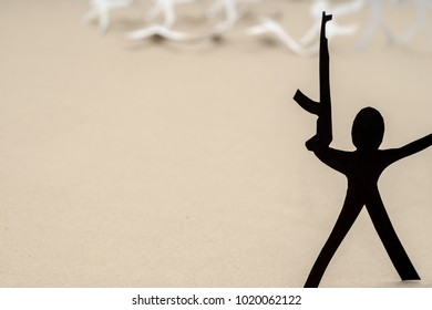 Terrorism, consequences, victims. Paper figures with automatic guns.