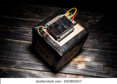 Terrorist bomb made at home with remote controlled detonator and lot of cables.