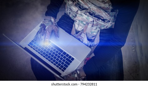 Terrorist with computer hacker working network on global warfare, Bandit,robber,thieve,gangster online hack worker concept.