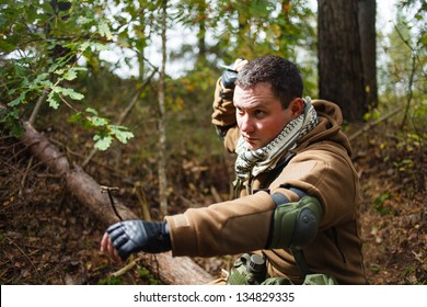 Terrorist at forest throwing knife.