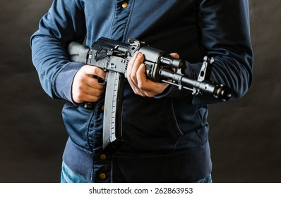 terrorist holding kalashnikov rifle isolated on a black background