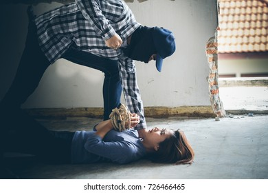 A terrorist man are attacking young women for a hostage in abandoned building. Rape, terrorism, crime, violence, robbery and killer of women conception.