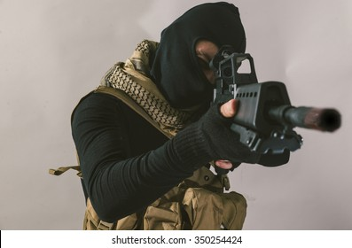 Terrorist sniper shooting with his weapon. Concept about terrorism