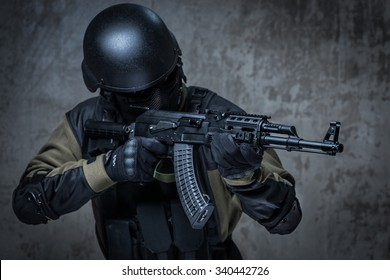 Terrorist soldier in a camouflage and helmet with rifle