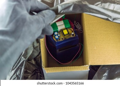 terrorist threat: a bomb that a terrorist hides in a box and wraps in a package
