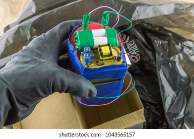 terrorist threat: a homemade bomb with a timer, a terrorist disguises the device in the box