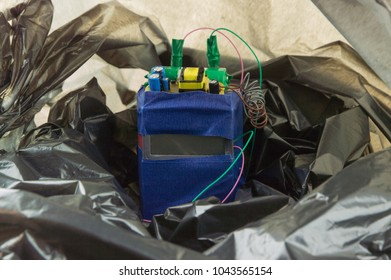 terrorist threat: an Improvised explosive device in a black plastic bag