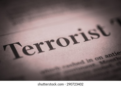 Terrorist written newspaper, shallow dof, real newspaper.