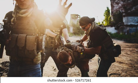 Terrorists with weapon captured soldier hostage